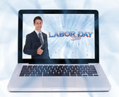 Man with thumbs up and labor day sign — Stock Photo