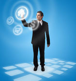 Business man pressing button — Stock Photo