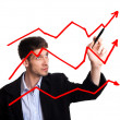 Businessman drawing chart in whiteboard — Stock Photo #5574687