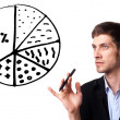 Businessman drawing pie chart in whiteboard — Stock Photo