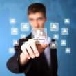 Foto Stock: Man pressing social network icon