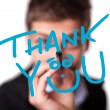 Stock Photo: Young mwriting Thank YOU on whiteboard