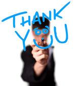 Genç adam teşekkürler beyaz tahta üzerine yazma — Stok fotoğraf