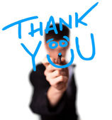 Jonge man schrijven dank u op whiteboard — Stockfoto