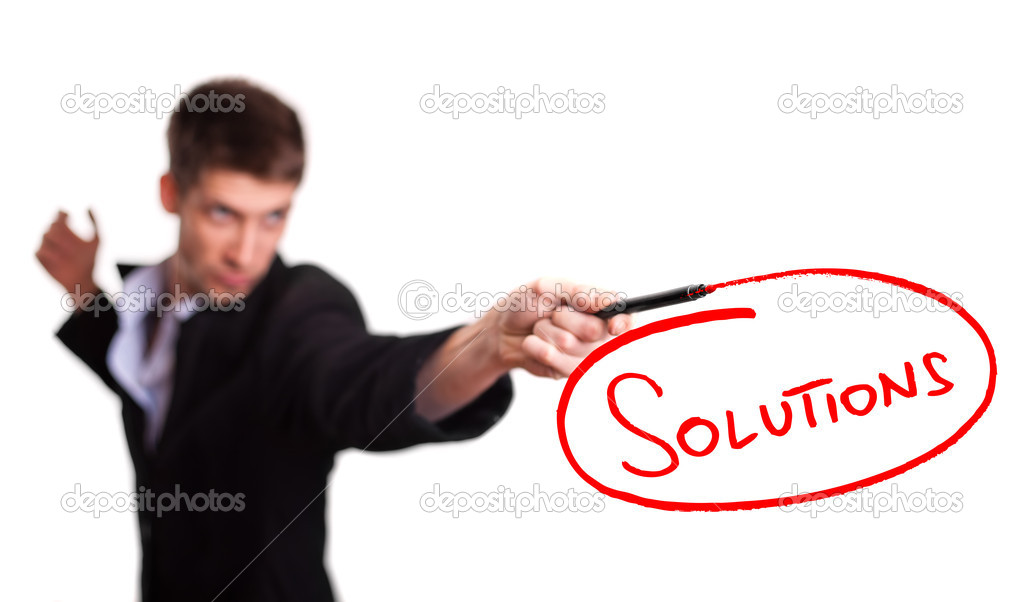 Businessman drawing solutions on whiteboard (selective focus) — Stock Photo #5837121