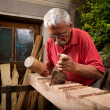 Woodcarver working with mallet and chisel 5 — Stock Photo