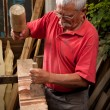 Woodcarver working with mallet and chisel 2 — Stock Photo