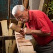 Woodcarver working with mallet and chisel — Stock Photo #6115657