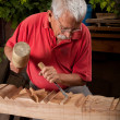 Woodcarver working with mallet and chisel — Stock Photo #6115665