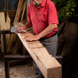 Woodcarver working with mallet and chisel — Stock Photo #6115675