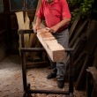 Woodcarver working with mallet and chisel - Stock Photo