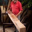 Woodcarver working with mallet and chisel — Stock Photo #6115677