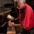 Woodcarver working with mallet and chisel — Stock Photo #6115678