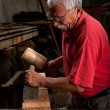 Woodcarver working with mallet and chisel — Stock Photo
