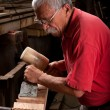 Woodcarver working with mallet and chisel — Stock Photo #6115682