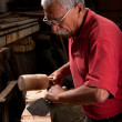 Woodcarver working with mallet and chisel — Stock Photo #6115683