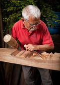 Woodcarver working with mallet and chisel 9 — Stock Photo