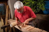 Woodcarver working with mallet and chisel 7 — Stock Photo