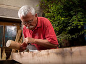 Woodcarver working with mallet and chisel 6 — Stock Photo