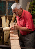 Woodcarver working with mallet and chisel 3 — Stockfoto