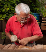 Woodcarver working with mallet and chisel 10 — Stock Photo