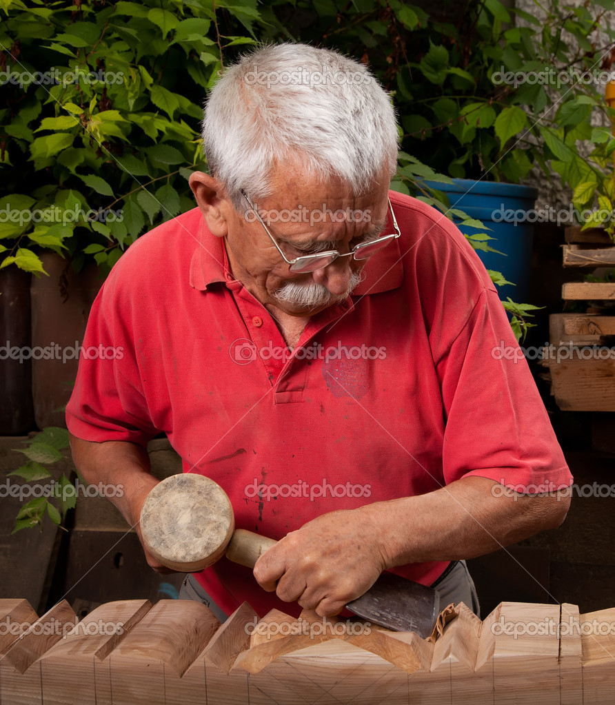 Old woodcarver working with mallet and chisel 10  Stock Photo #6264488