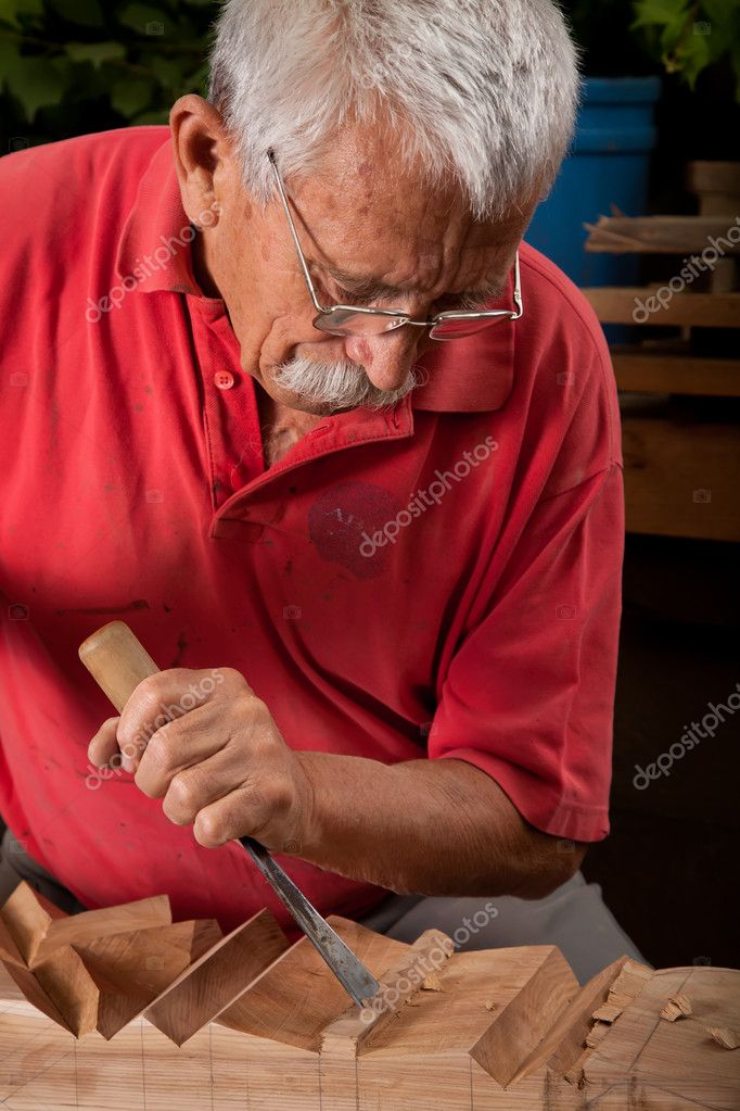 Old woodcarver working with mallet and chisel — Stock Photo #6264497