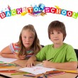 Stock Photo: Kids with back to school theme isolated on white