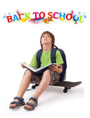 Kid on skateboard with back to school theme isolated on white — Stock Photo