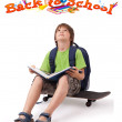 Kid on skateboard with back to school theme isolated on white — Stock Photo #6422219
