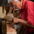 Old woodcarver working with mallet — Stock Photo #6422239