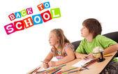 Niños con volver al tema escolar aislado en blanco — Foto de Stock