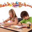 Stock Photo: Kids looking with back to school theme isolated on white