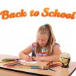 Stock Photo: Young girl drawing with back to school theme isolated on white