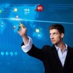 Businessman pressing social media button on digital map — Stock Photo