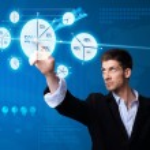 Businessman pressing pie chart button — Stock Photo