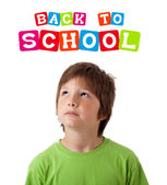 Boy looking with back to school theme isolated on white — Stock Photo