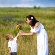 Royalty-Free Stock Photo: Son gives mom flowers