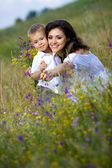 Son and mom on the nature — Stock Photo