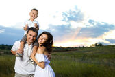 Young happy family — Stock fotografie