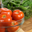 Fresh tomatoes and spinach bowls — Stock Photo #5936154