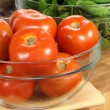 Stock Photo: Fresh tomatoes and spinach bowls