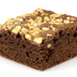 Royalty-Free Stock Photo: Chocolate brownie with cracked peanuts on top