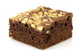 Chocolate brownie with cracked peanuts on top — Stock Photo