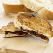 Delicious rustic hazelnut spread and jelly sandwich - Stok fotoğraf