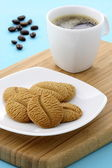 Delicious coffee shortbreads and hot coffee — Stock Photo