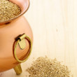 Raw quinoa on copper pot - Stock Photo