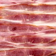 Cured delicious pancetta — Stock Photo