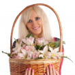 Girl with a flowers basket on a white background — Foto de Stock