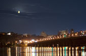 Moonset in Kiev over Dnieper river in lights — Stock Photo